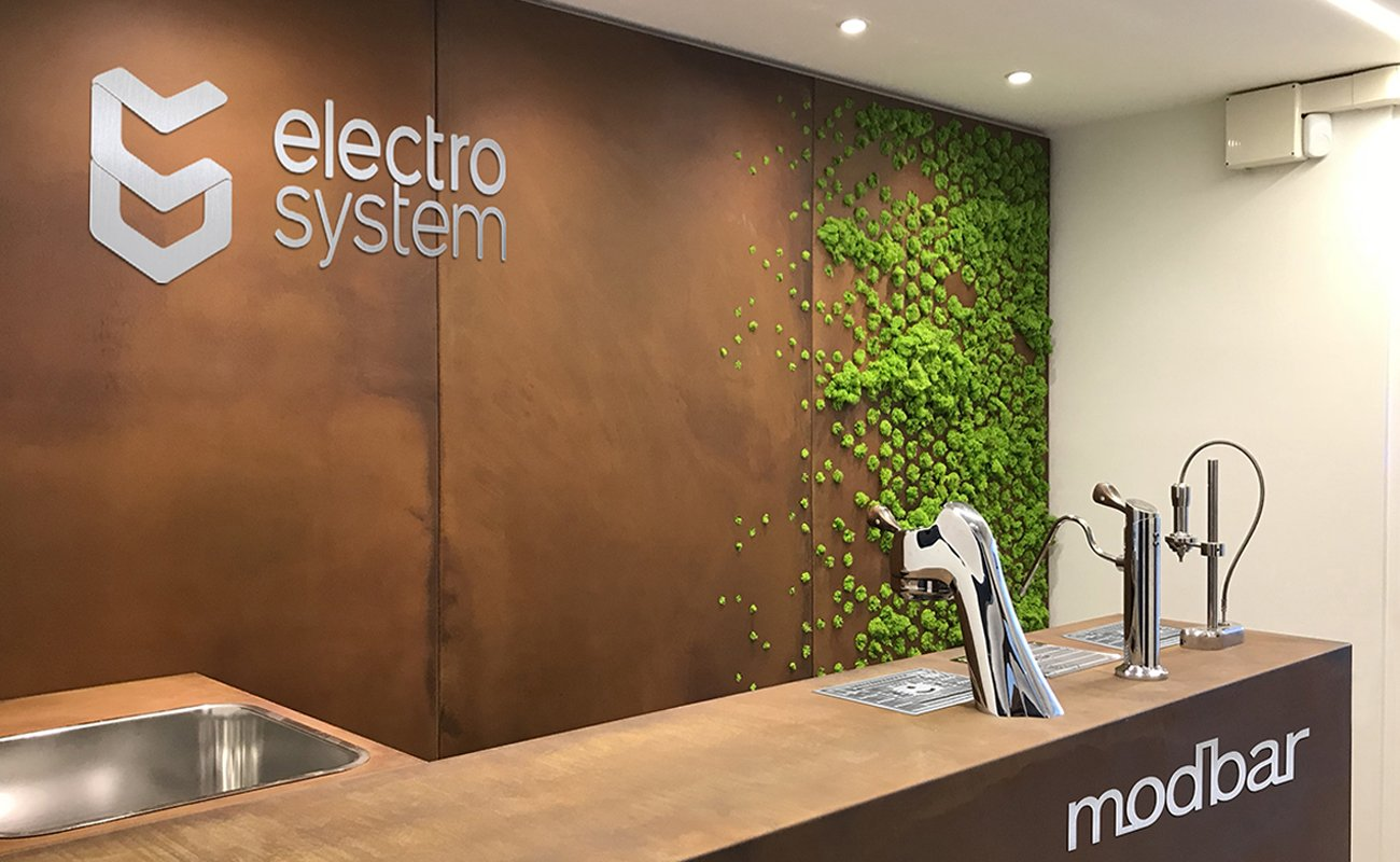 Corten wall with inserts in lichens at the Electro System corner bar